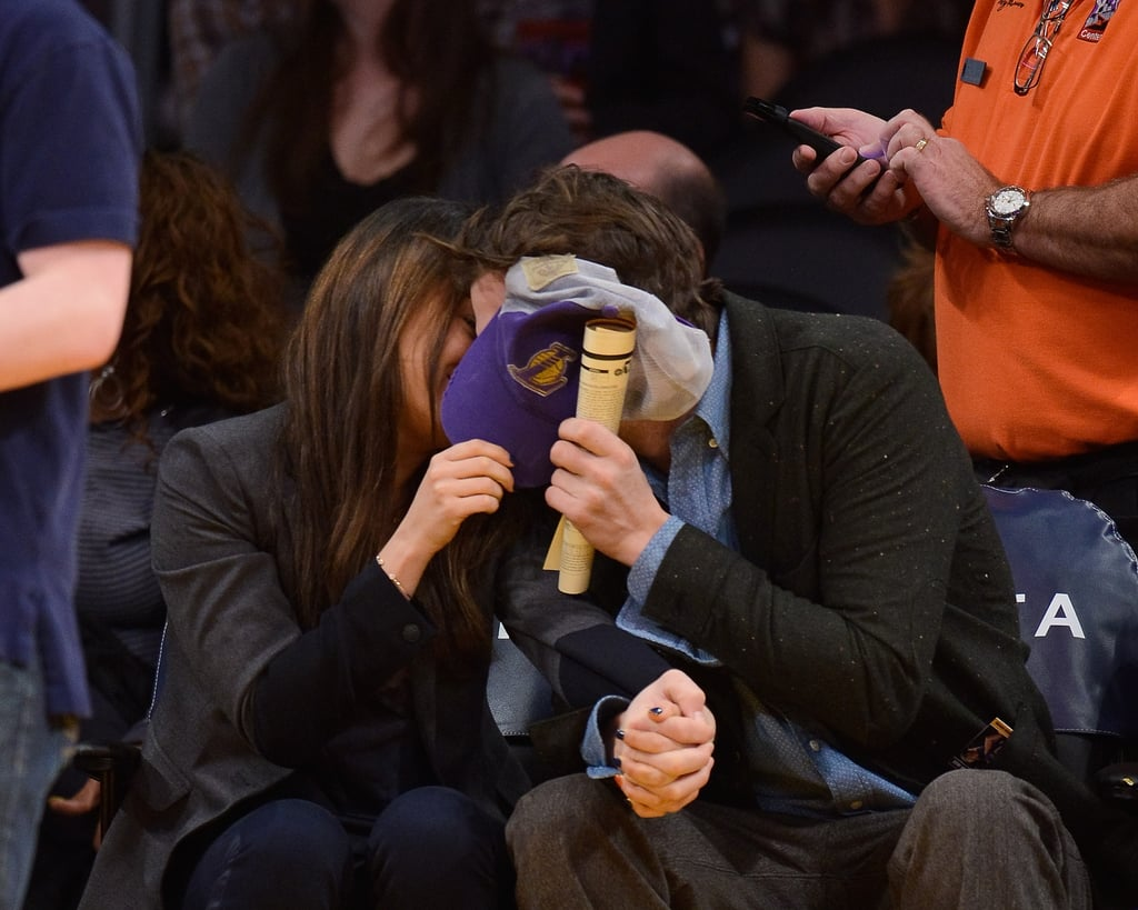 The sweet duo snuck a kiss at a January 2014 Lakers game in LA.