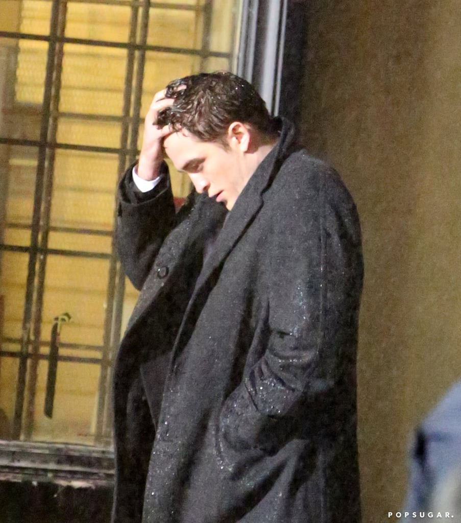 Where's your umbrella, Robert Pattinson!? The actor filmed a rainy scene for his new movie, Life, in Toronto on Thursday.