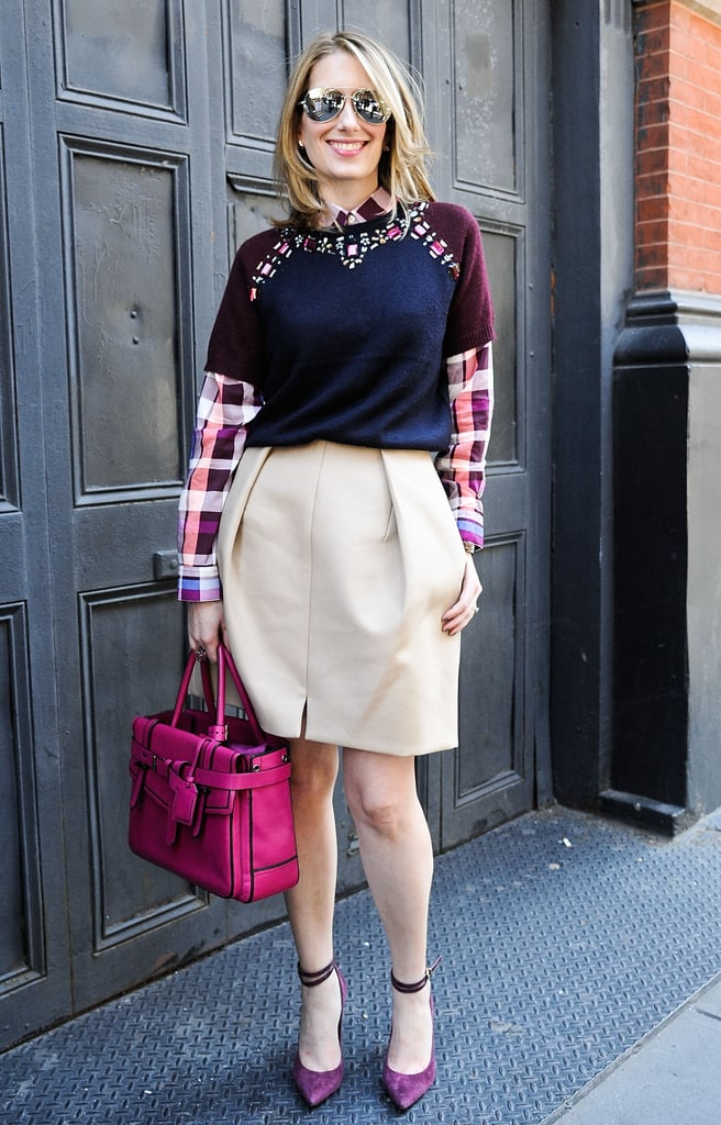 POPSUGAR Fashion and Beauty Director Melissa Liebling-Goldberg layered up in an embellished knit and plaid button-down — extra points for that pop of pink on her Reed Krakoff bag.