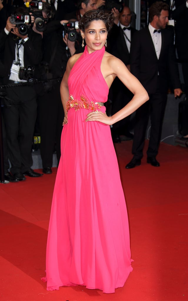 Freida Pinto dazzled the crowd in a pink halter Gucci gown featuring a beautiful belt at the Cannes premiere of The Great Gatsby.