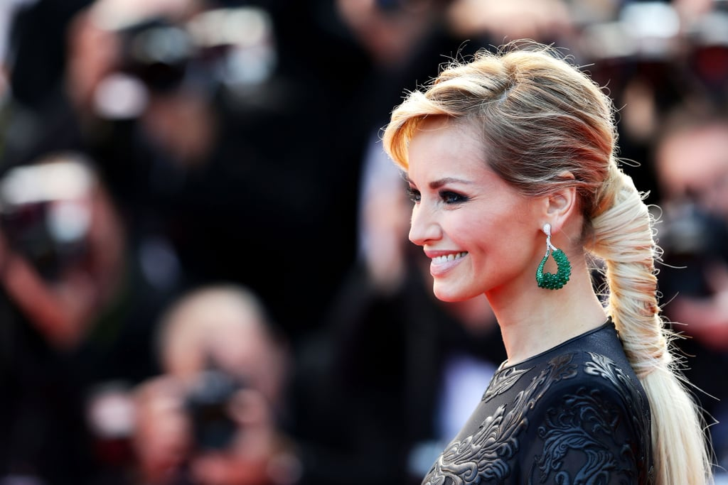 Model Adriana Karembeu wore a modern take on the ponytail on the Cleopatra red carpet.