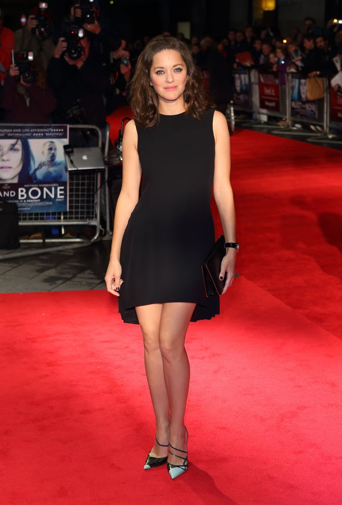 Marion Cotillard wore a little black Christian Dior Spring 2013 dress, which featured a high-low hemline, at the BFI London Film Festival.