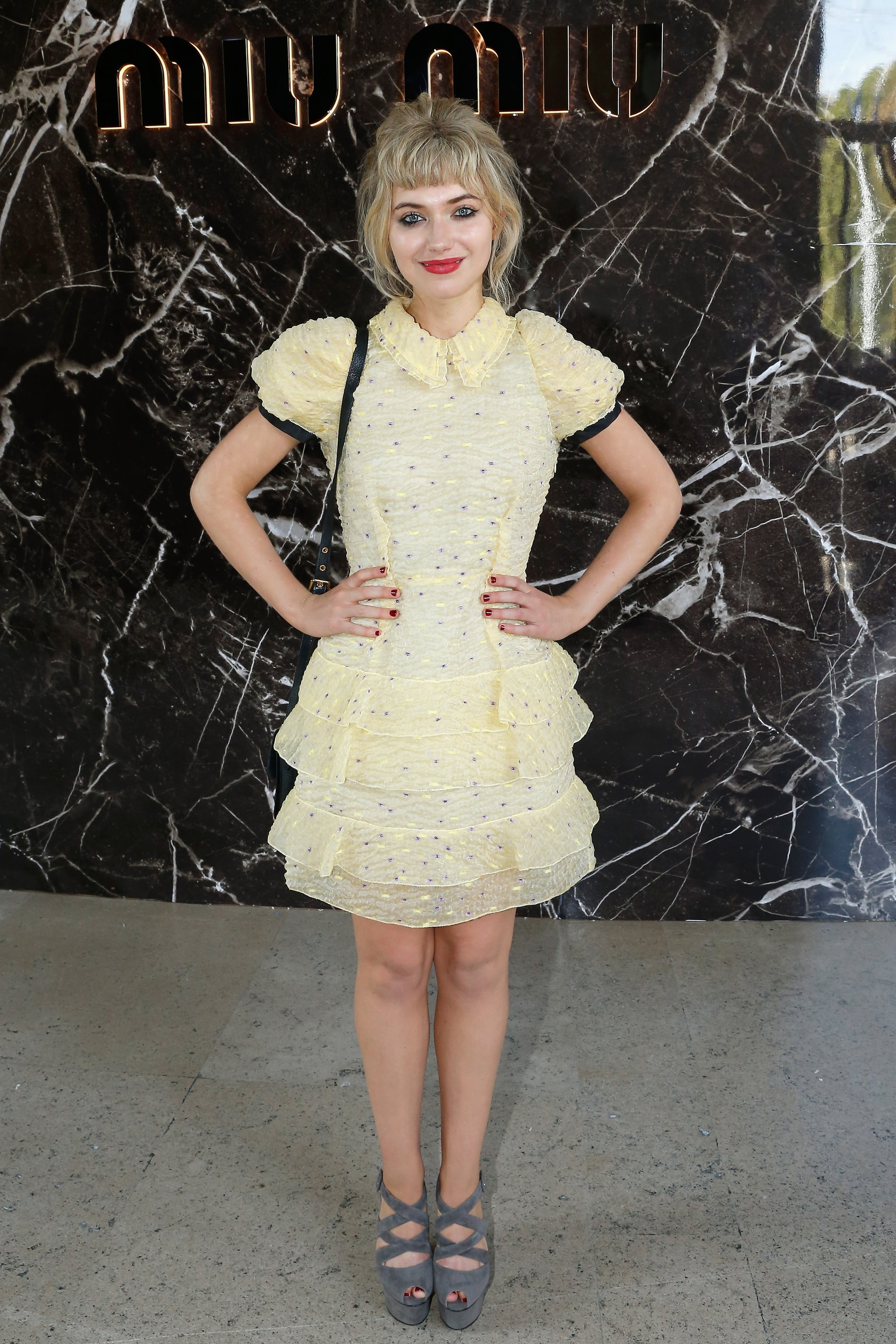 Sitting front row at Miu Miu, Imogen proved she can wear the label's most frilly, youthful creations with ease.