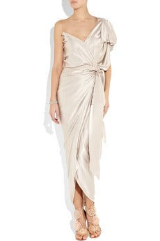 We love the asymmetrical cut, the ruched detailing and the luxe satin.  Lanvin Asymmetric Silk-Satin Wrap Gown ($4,890)