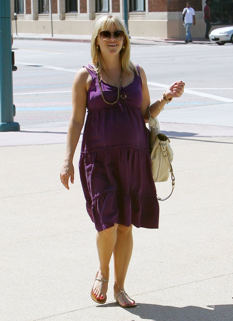 Reese Witherspoon toted a white bag.