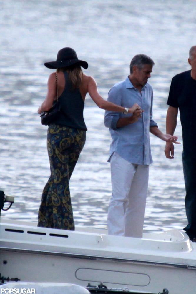 George Clooney helped Stacy Keibler onto his boat in Lake Como earlier this month.