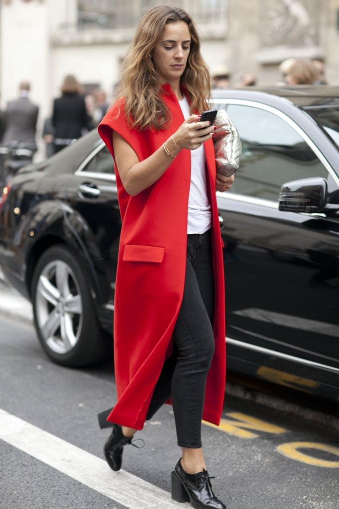A bold red coat is all the interest any outfit needs.