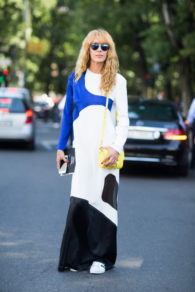 Take an elegant dress from night to day by adding sneakers, sunglasses, and bold accessories.