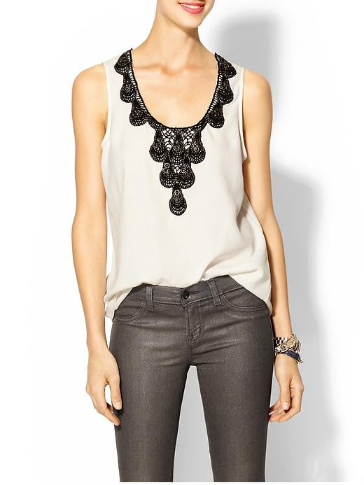 Spice up this Tinley Road Embellished Tank ($49) with waxed denim and a hot pair of heels.