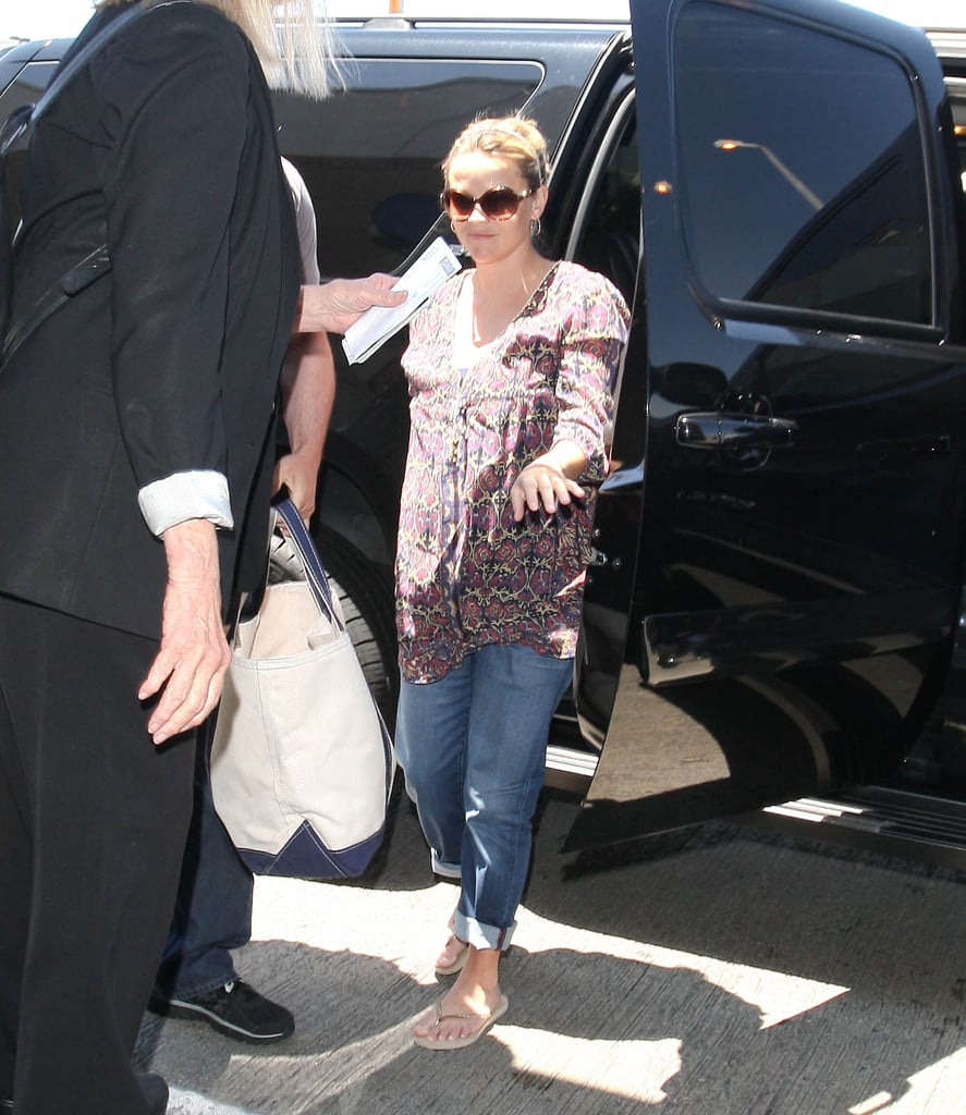 Reese Witherspoon stepped out of an SUV at the airport in LA.