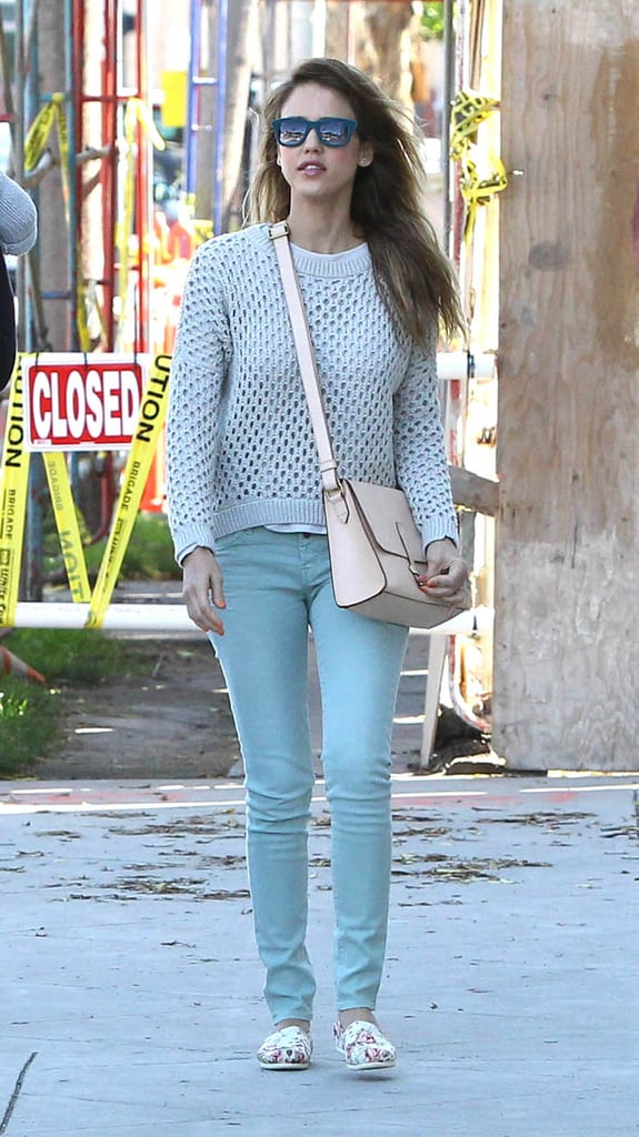 Jessica stuck with an icy blue palette, donning a knit Paper Denim & Cloth sweater and light blue denim. Ever the stylist, she injected a pop of print via floral slip-ons in LA.