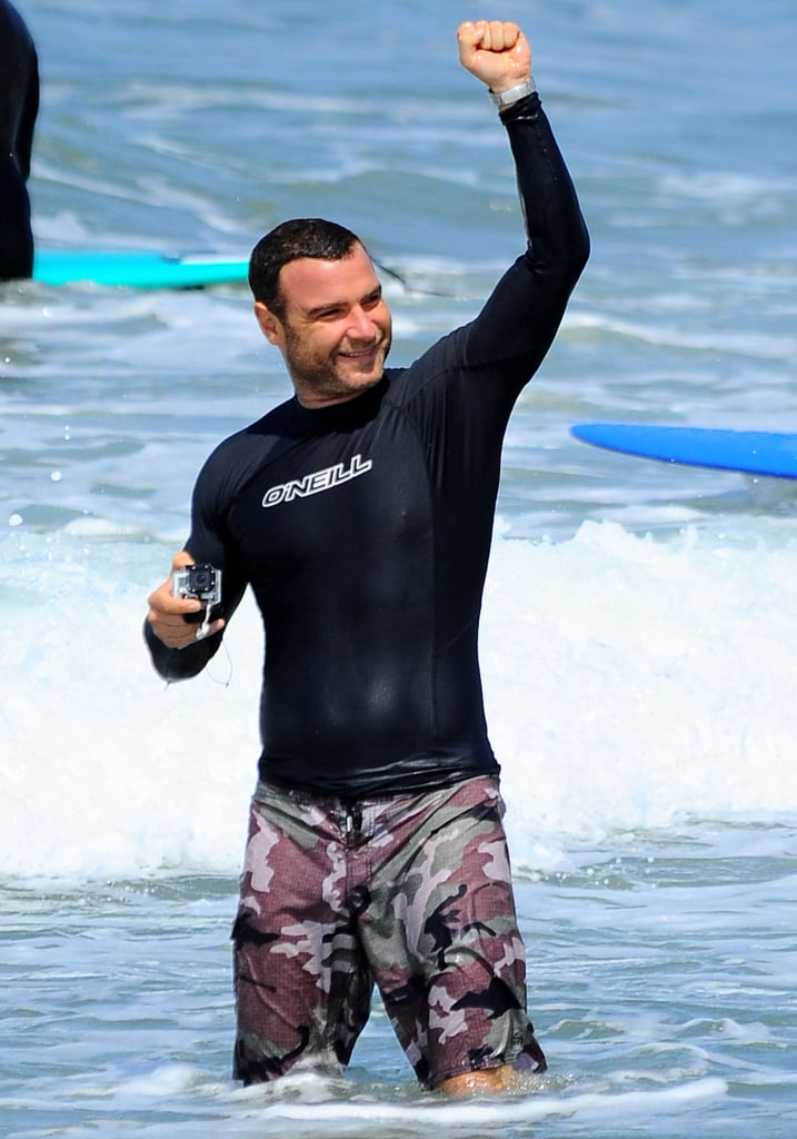 Liev Schreiber got excited while surfing with his family in LA on Sunday.