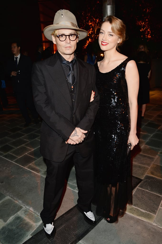 Johnny Depp and Amber Heard kept close to one another during the Art of Elysium dinner in LA on Saturday.