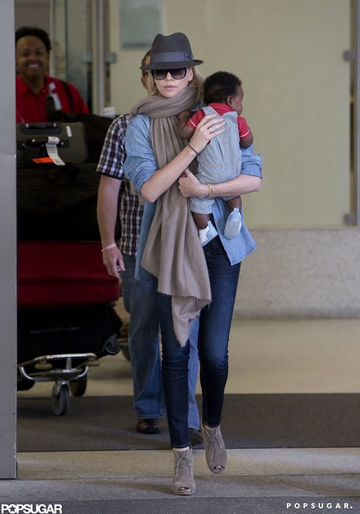 Charlize Theron and baby Jackson arrived home in LA after doing press for Snow White and the Huntsman.