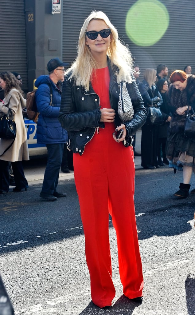 Zanna Roberts Rossi added edge to her red jumpsuit with a double-breasted motorcycle jacket.