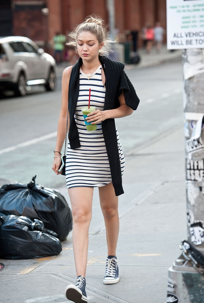 She knows how to rock a dress and sneakers.