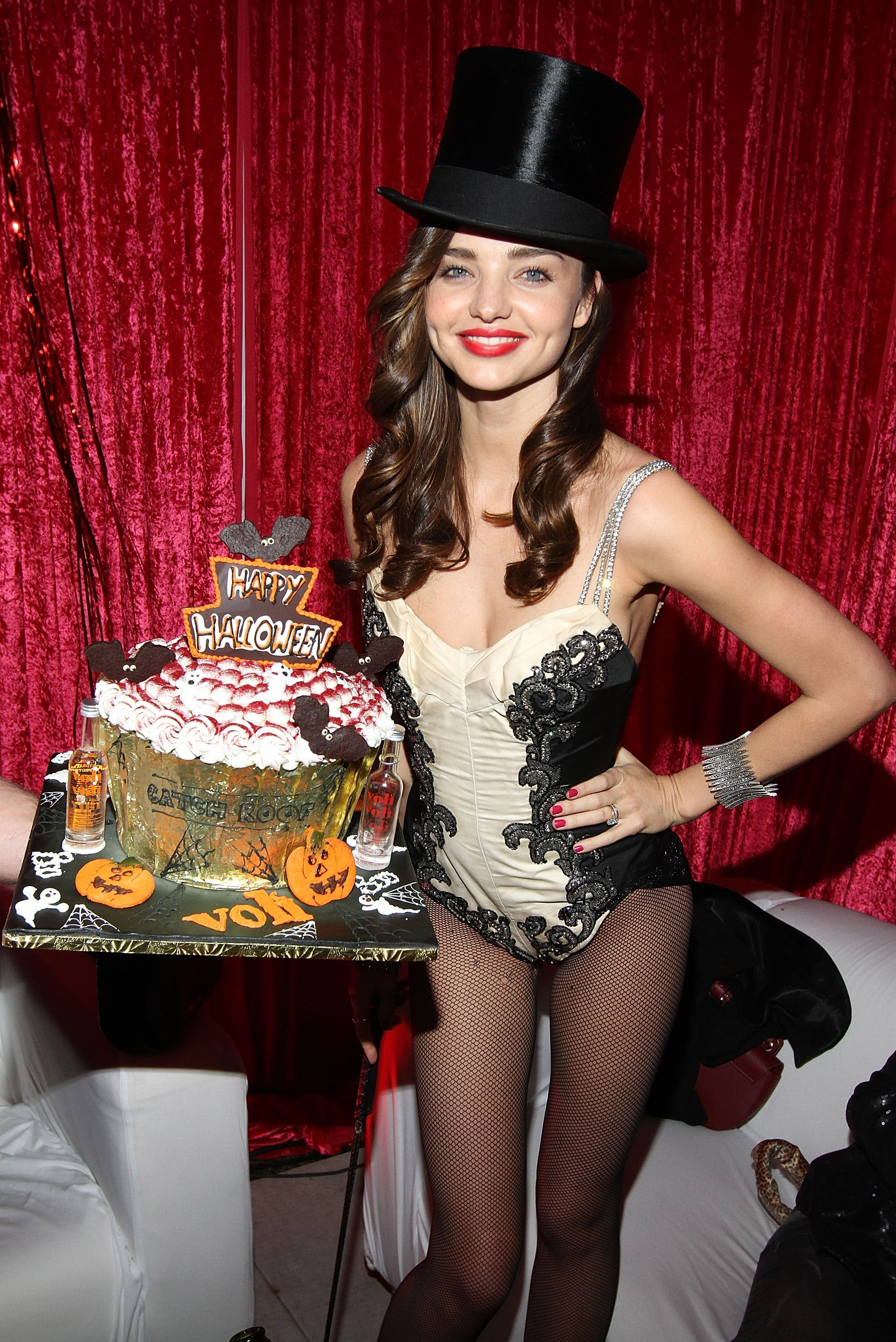 Miranda Kerr wore a top hat at a Halloween party.