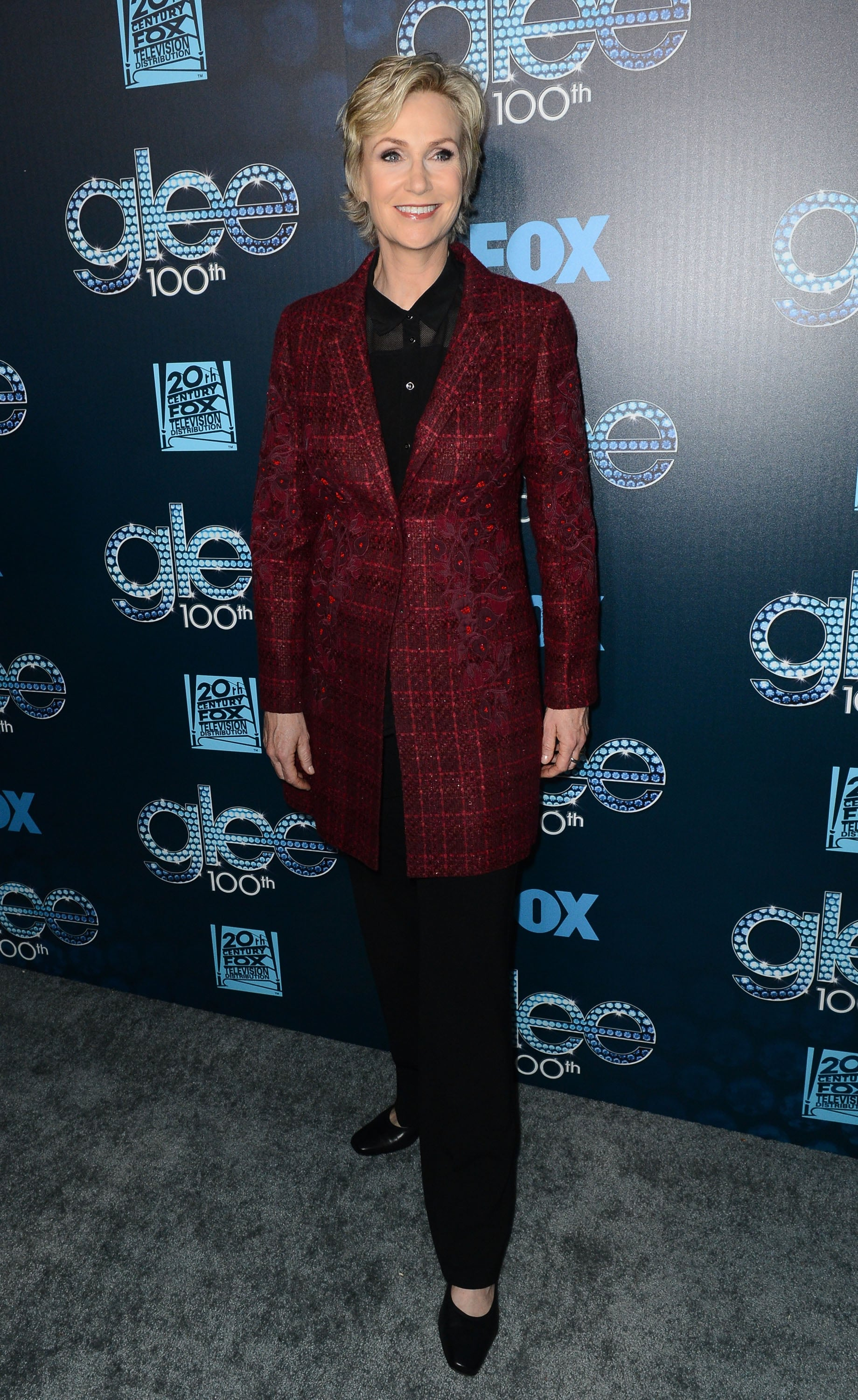 Jane Lynch wore plaid.