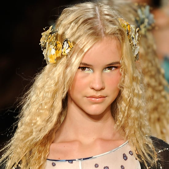 Spring goddesses everywhere, whether very formal guests or extremely casual brides, should love this look. It simply involves braiding wet hair overnight (or using a crimping iron the morning of) to create geometric waves. Add beautiful hair clips (the butterfly combs from Diane von Furstenberg are especially gorgeous) and you've got your look.