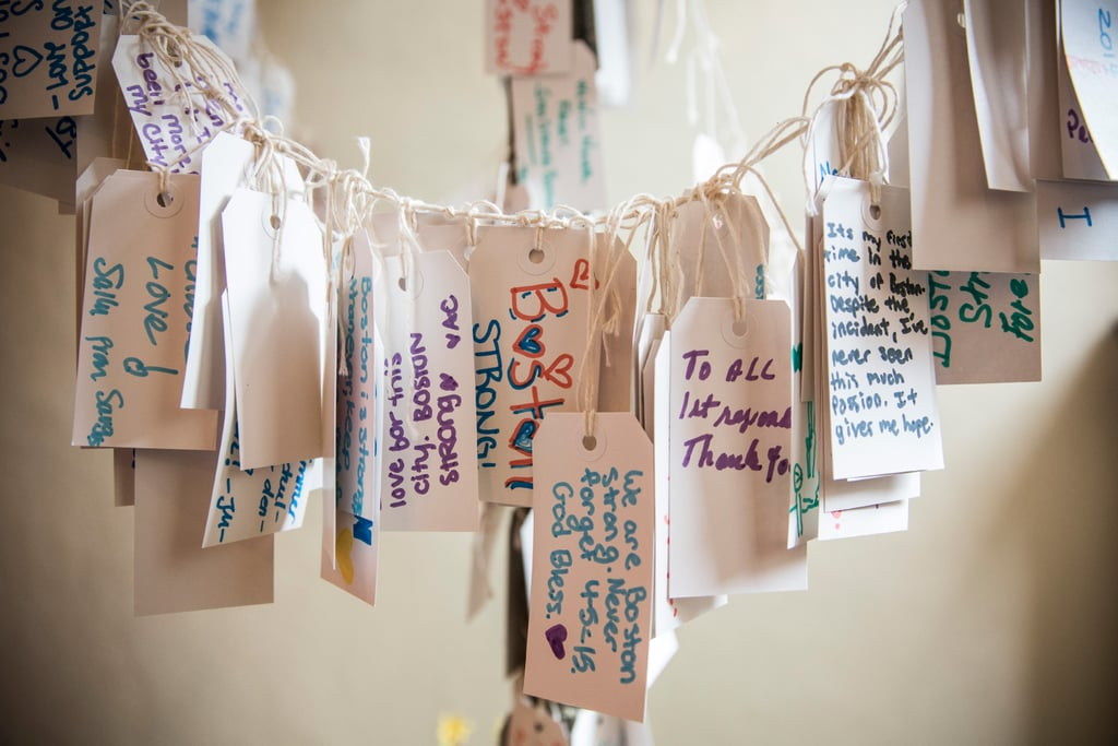 A collection of handwritten messages were hung at the Boston Public Library as part of its Dear Boston: Messages From the Marathon Memorial exhibition.
