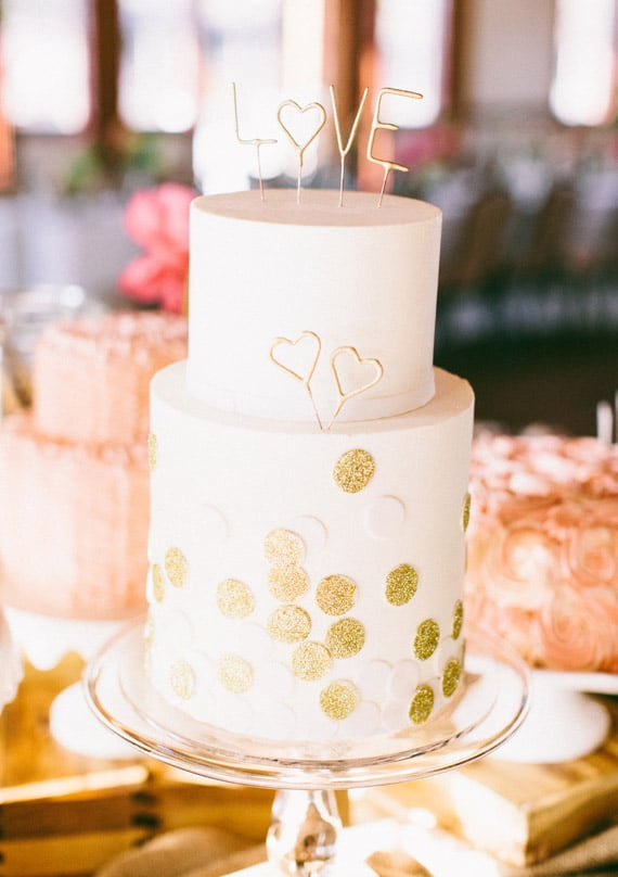 """Decorate your cake with gold dots and letters that say """"love,"""" and it'll instantly be one for the books.  Photo by Ciara Richardson via 100 Layer Cake"""