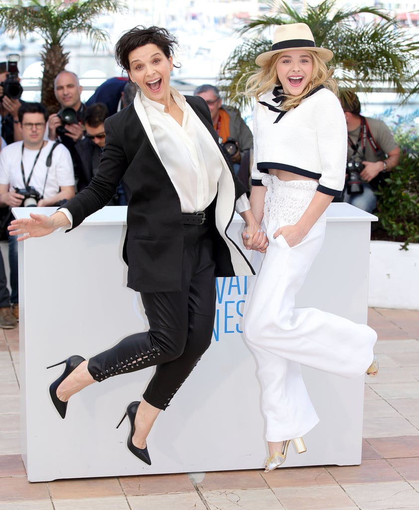 Chloe Grace Moretz and Juliette Binoche got animated while promoting Clouds of Sils Maria.