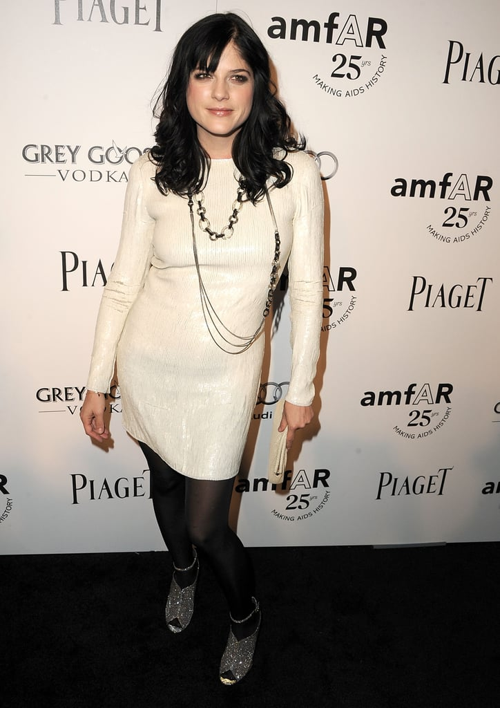 Selma Blair opts for a shimmering Winter white minidress.
