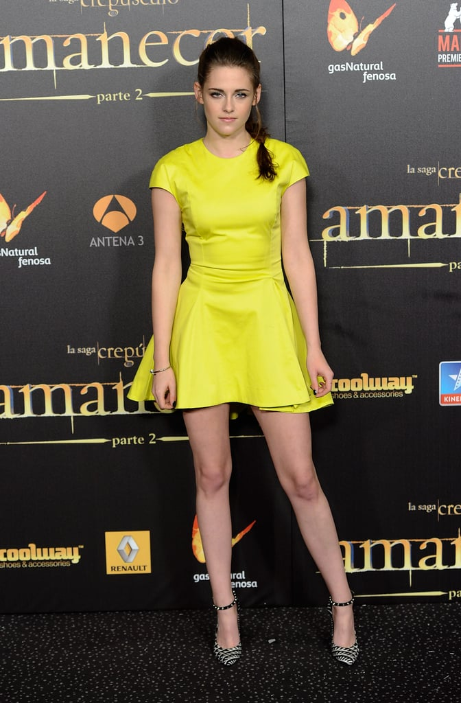 Stewart wore a vibrant neon yellow Christian Dior mini and ankle-strap heels for the Breaking Dawn Part 2 premiere in Madrid in November 2012.