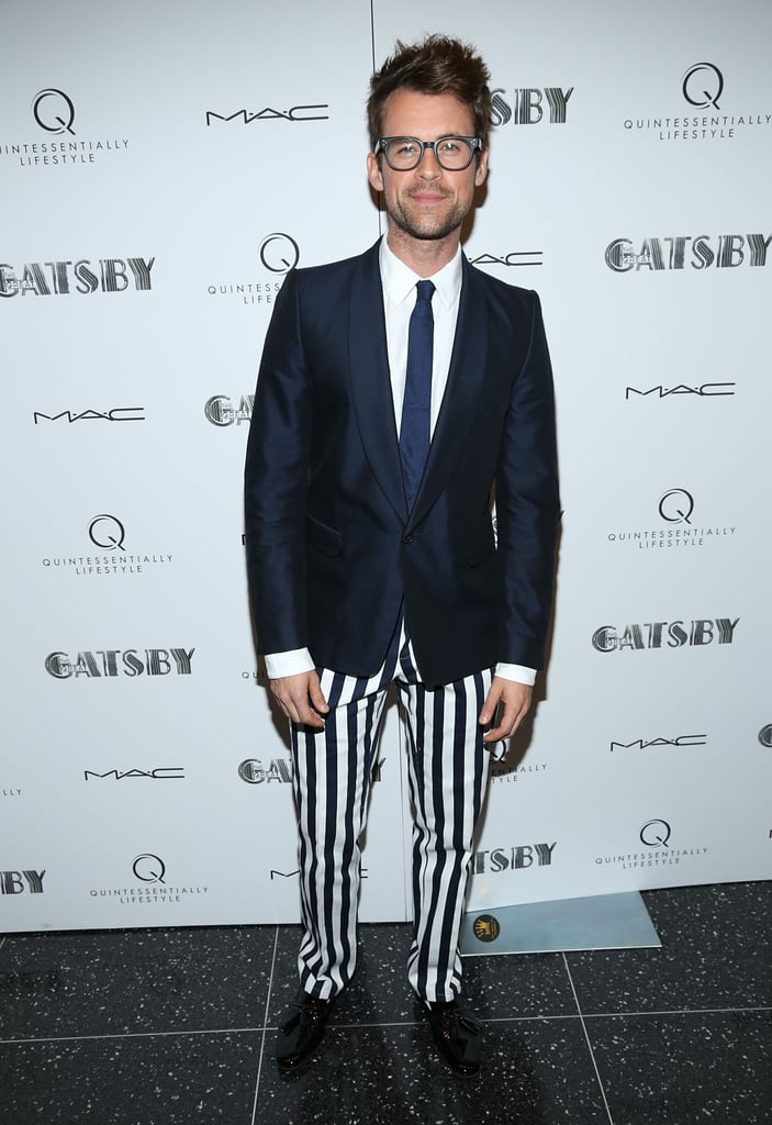 We love Brad Goreski's quirky spin on the suit, in a pair of striped trousers and a navy blazer.