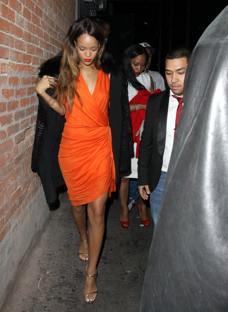 In February 2013, Rihanna swapped the pink Valentine's Day palette for a bright orange wrap dress in Hollywood.