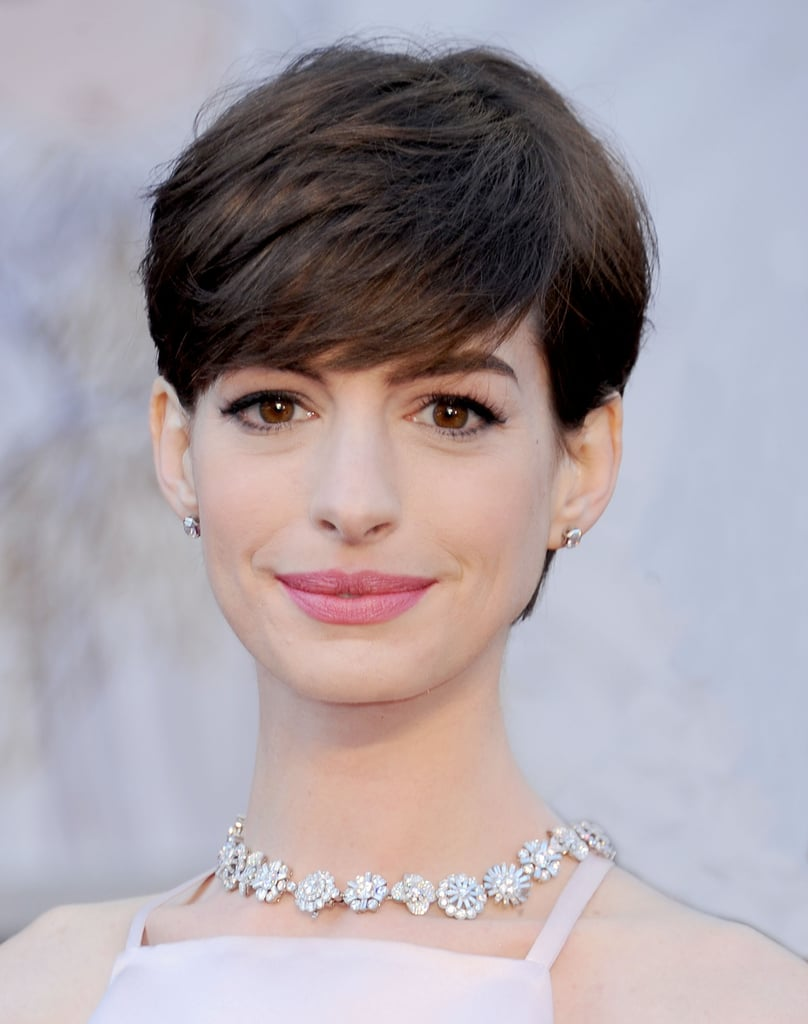 """In 2010, Anne Hathaway told British GQ why she's no longer Catholic, linking it to her brother Michael: """"Well, the whole family converted to episcopalianism after my elder brother came out. Why should I support an organization that has a limited view of my beloved brother? So I'm . . . nothing."""""""