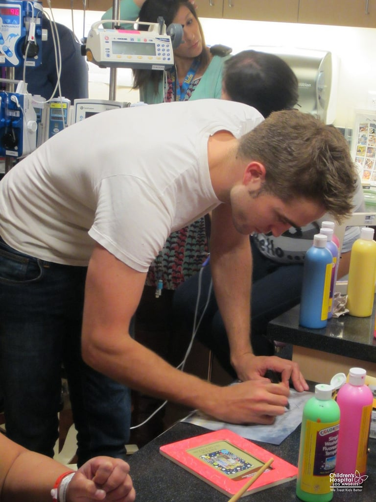 Robert Pattinson dove into some arts and crafts at the children's hospital. Source: Flickr user Children's Hospital Los Angeles
