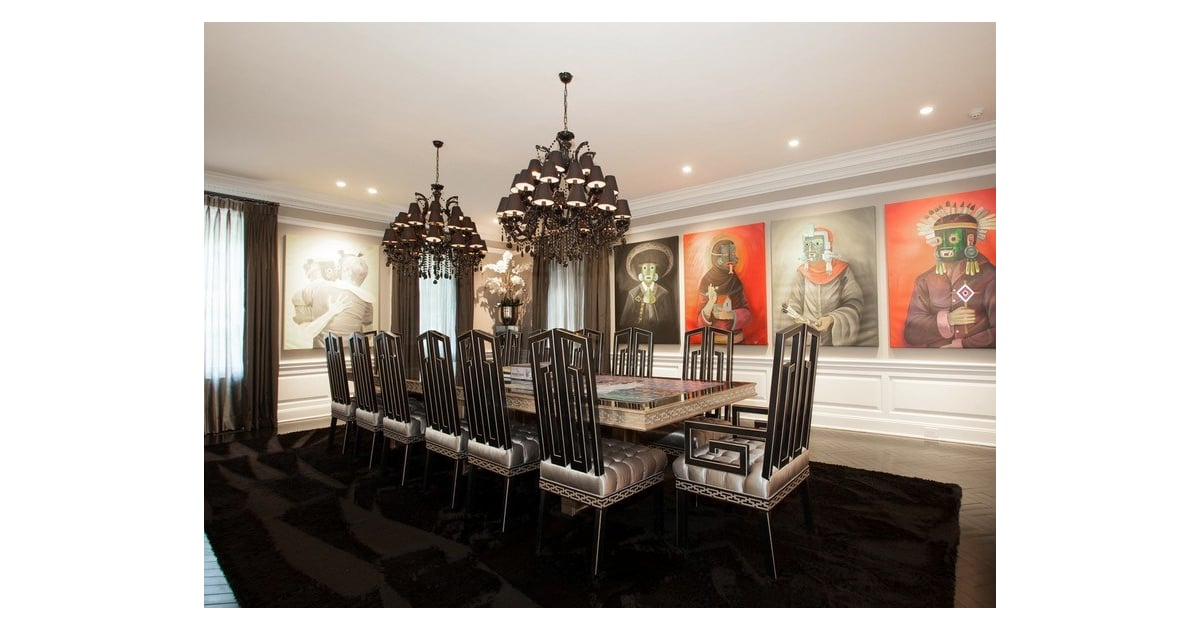 large paintings and dark decor give the dining room a gothic chic