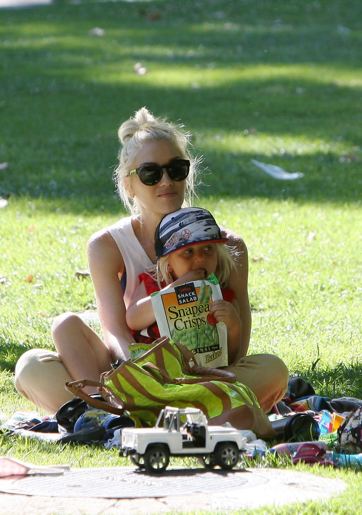 Gwen Stefani and Zuma Rossdale cuddled up in the shade.