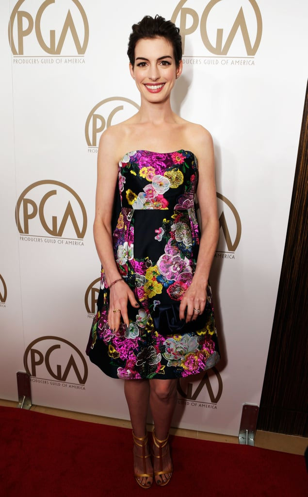 Anne Hathaway opted for a flirtier look, wearing a strapless floral Erdem dress paired with custom gold vegan Giuseppe Zanotti sandals and a Christian Louboutin clutch.
