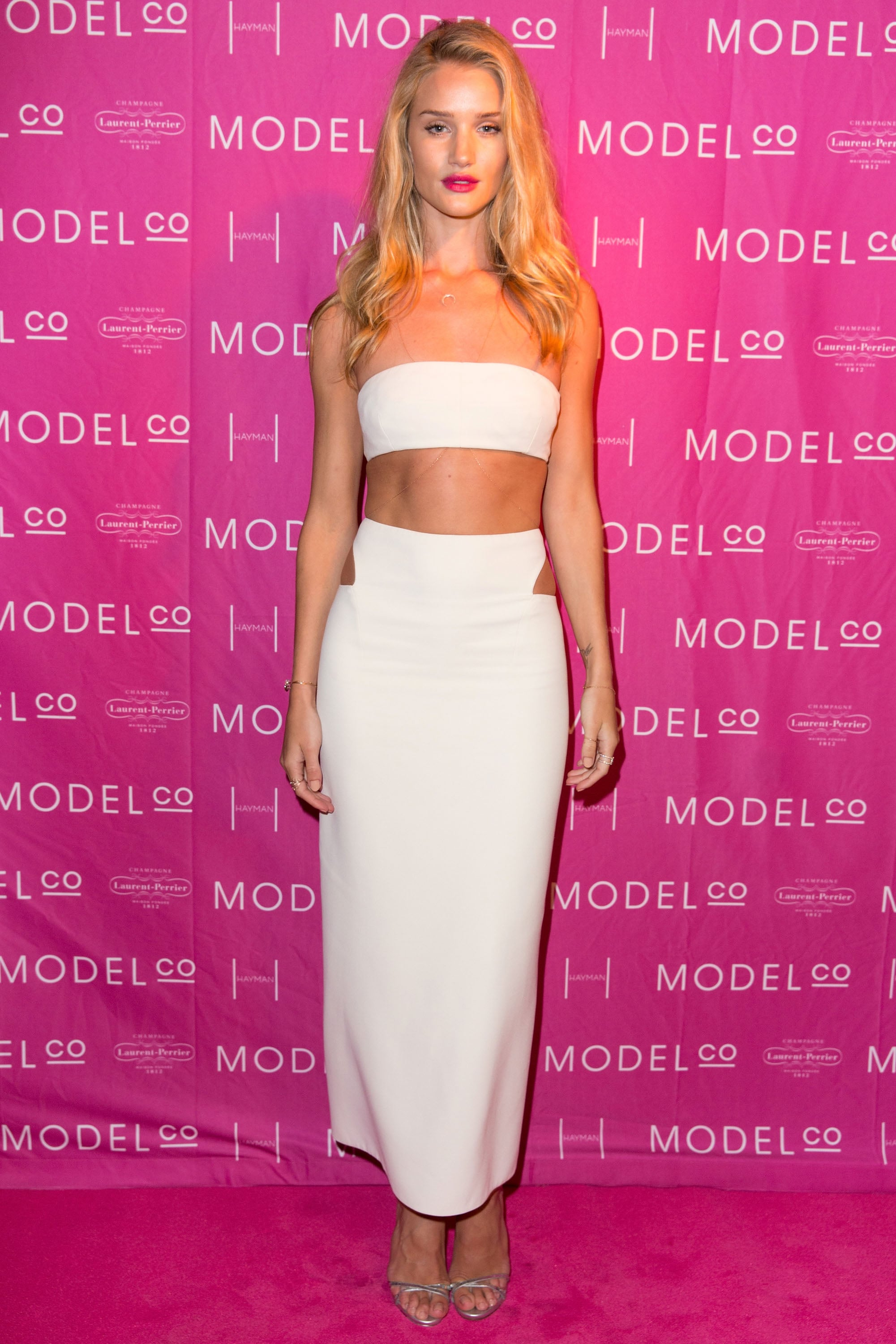 Rosie Huntington-Whiteley bared her midriff in Calvin Klein Collection's white designs at a Hayman Island dinner celebrating her ambassadorship.
