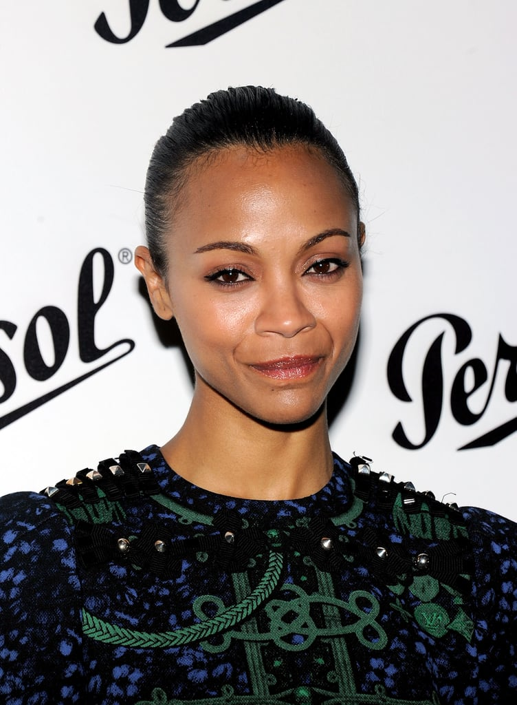 Zoe Saldana gave a smile at the Persol Magnificent Obsessions event in NYC.