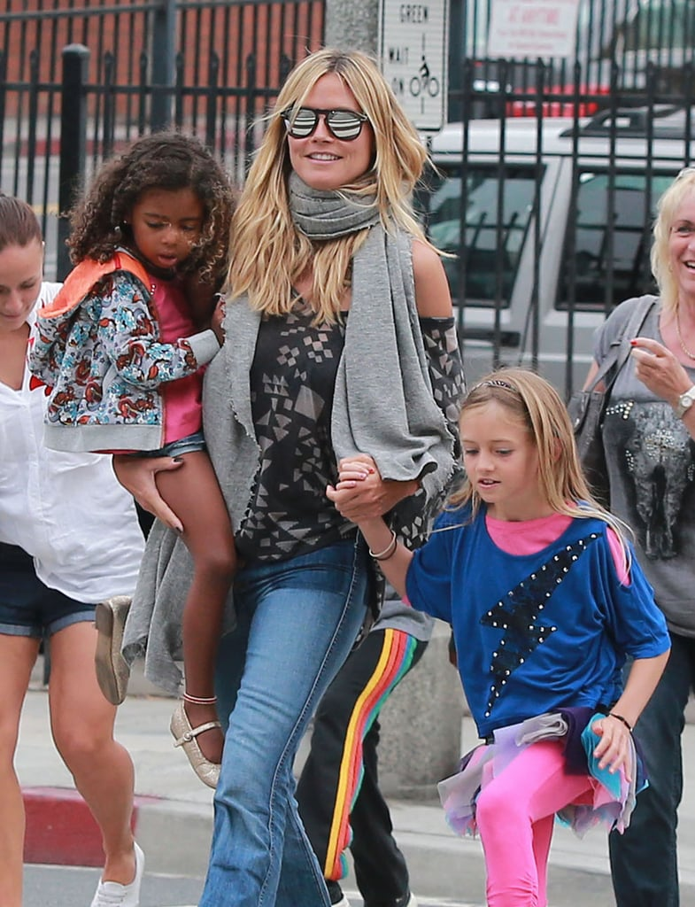 Heidi Klum held onto her daughters, Leni and Lou Samuel, after a family lunch in LA.