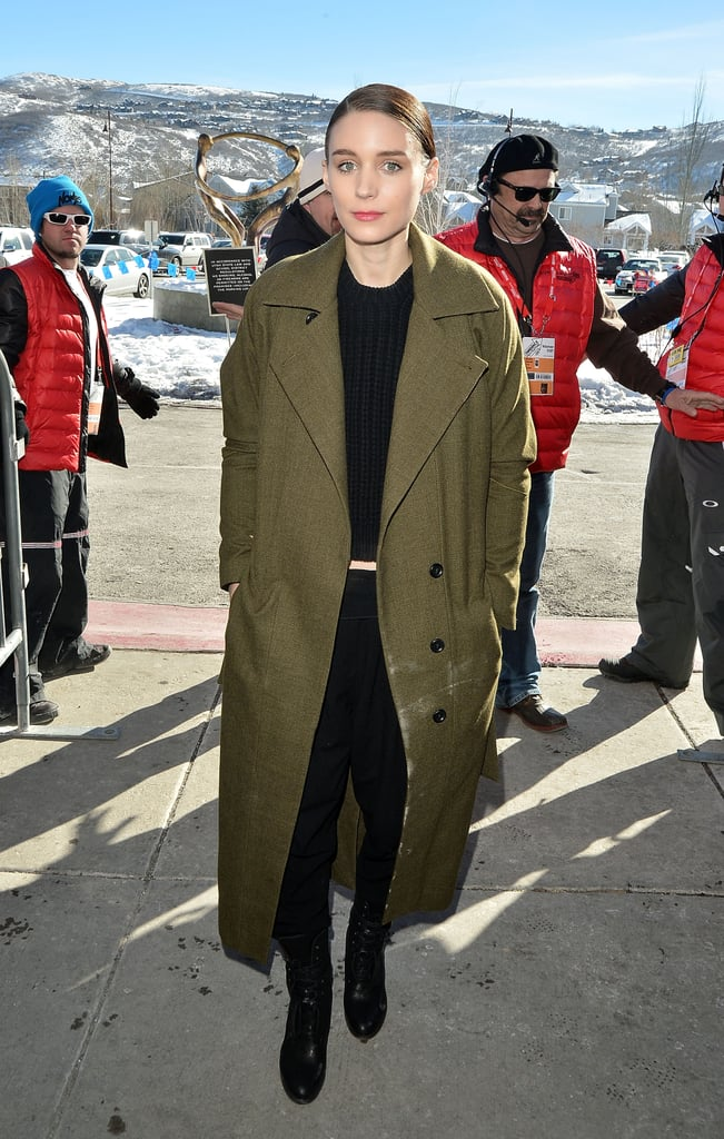 When outdoors, Rooney threw on an olive-green coat for a fashion-forward color pairing we love.