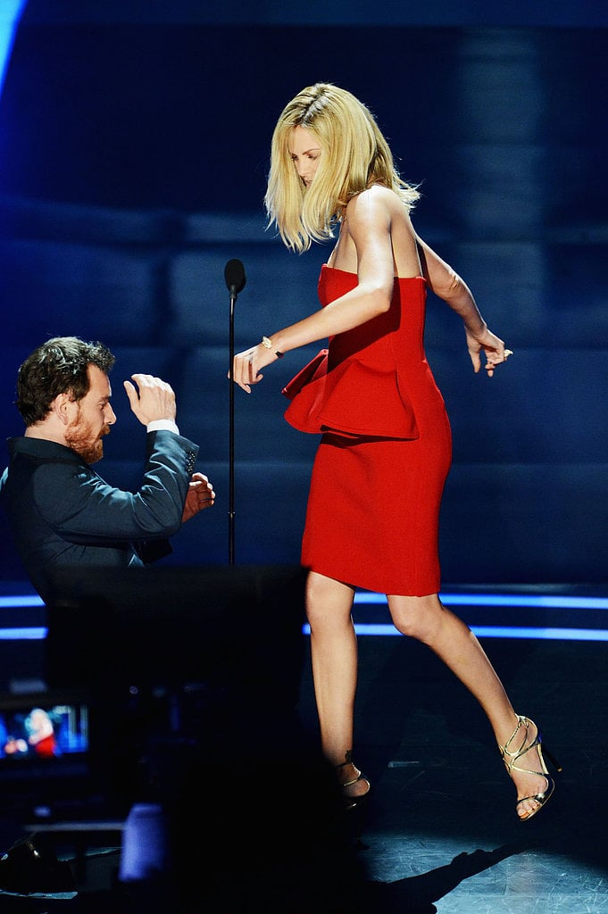 Charlize Theron pretended to beat up Michael Fassbender on stage at the 2012 show.