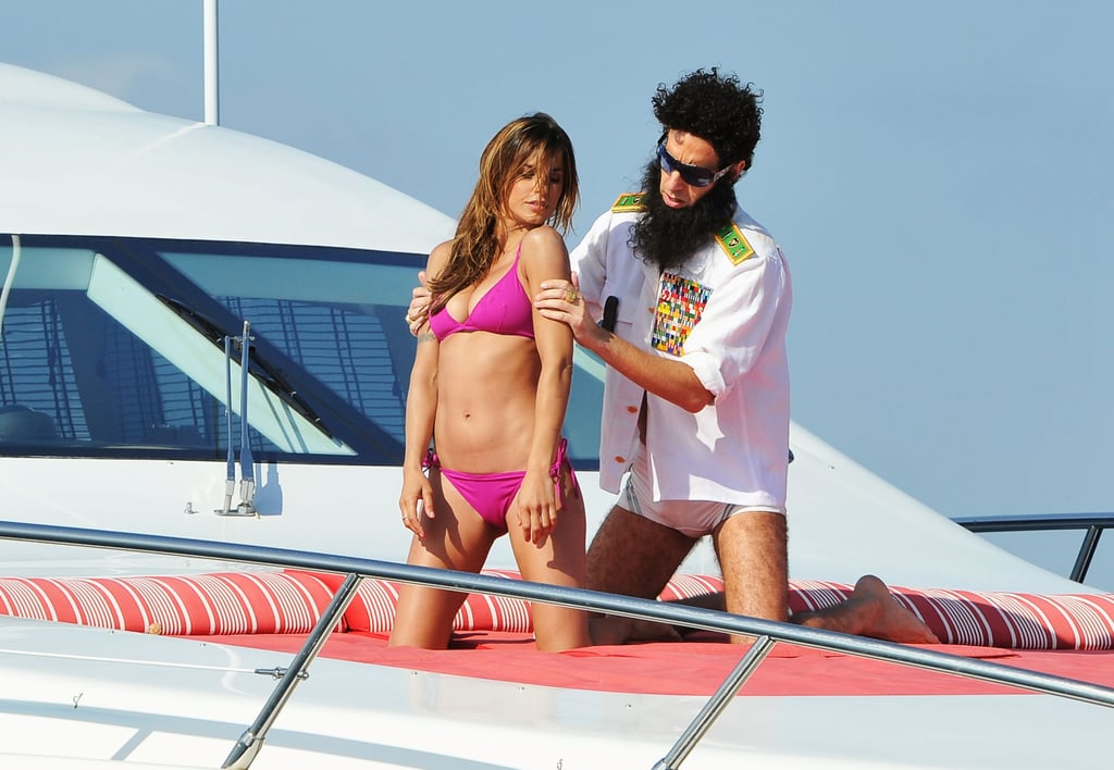 Sacha Baron Cohen, The Dictator, massaged Elisabetta Canalis on a yacht at the Cannes Film Festival.