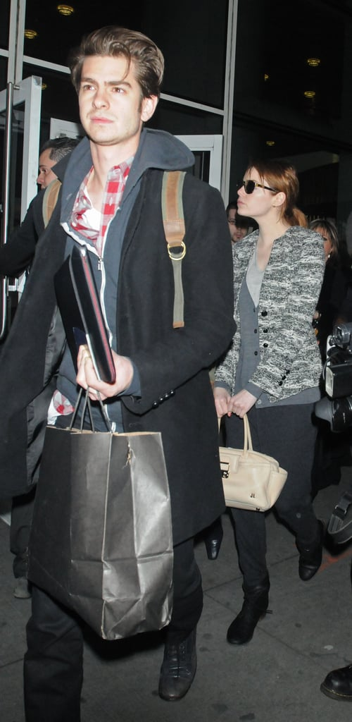 Emma Stone and Andrew Garfield are home after promoting The Amazing Spider-Man.