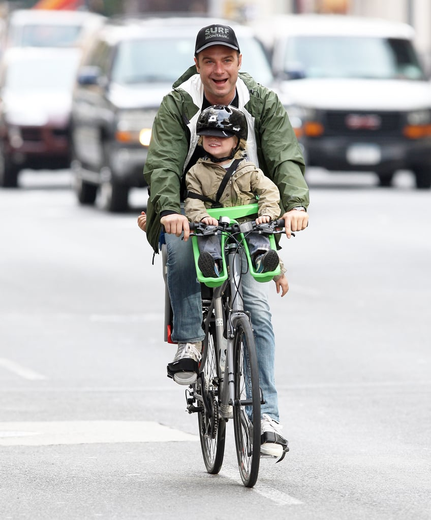 Liev Schreiber biking in NYC with Samuel.