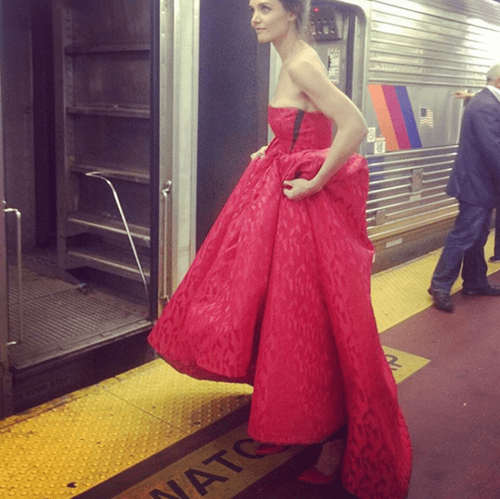Katie Holmes in Red Dress on a Train | Instagram