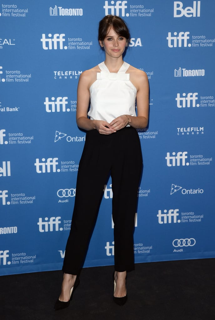 Felicity Jones was sleek in a white bow blouse and black trousers at The Invisible Woman press conference in Toronto.