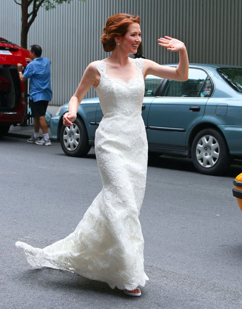 Ellie Kemper wed in July 2012 in a floral-embroidered gown, only adding simple diamond drop earrings and swept-back hair into the wedding day mix.