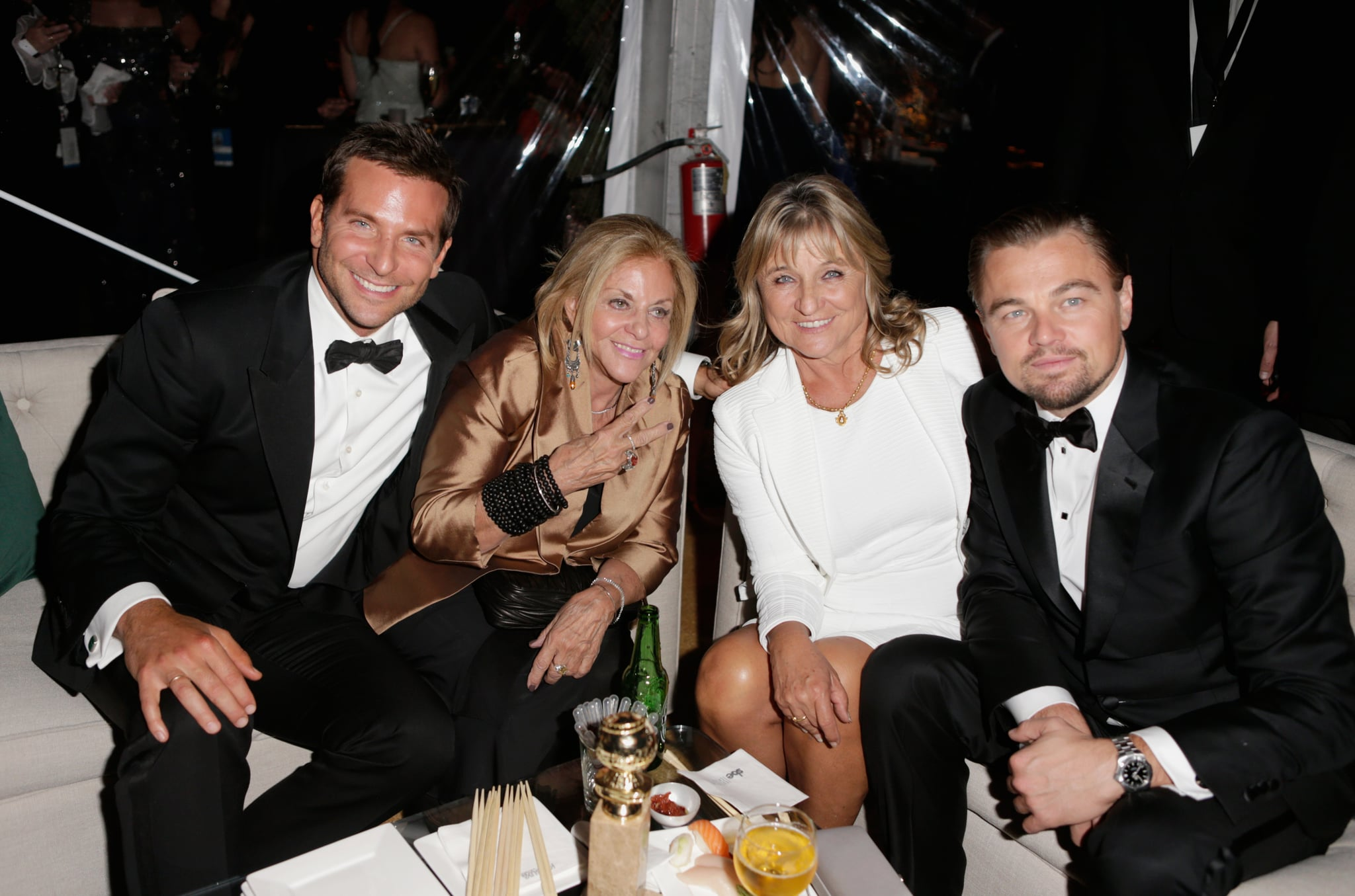 Mama's boys! Leonardo DiCaprio and Bradley Cooper got together with their moms at the Weinstein Company Globes afterparty.