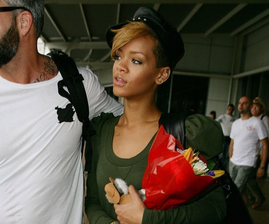 Slide Photo of Rihanna Arriving in Sydney Holding a Bouquet of Flowers