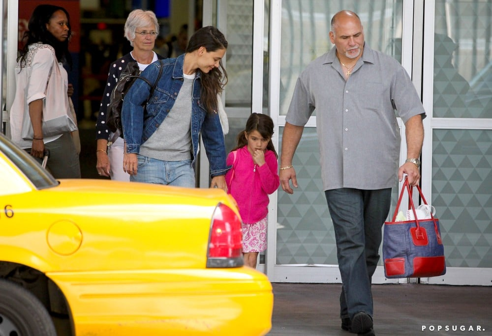 Katie Holmes and her mom, Kathleen, touched down in NYC with Suri Cruise.