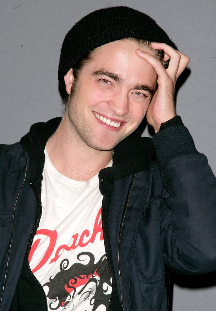 Rob didn't let a hat stop him from adjusting his locks during a visit to NYC's Apple store in November 2008.
